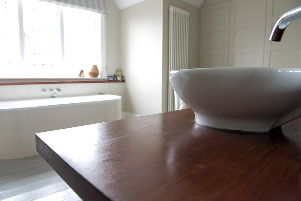 bathroom-sink-on-wooden-worktop
